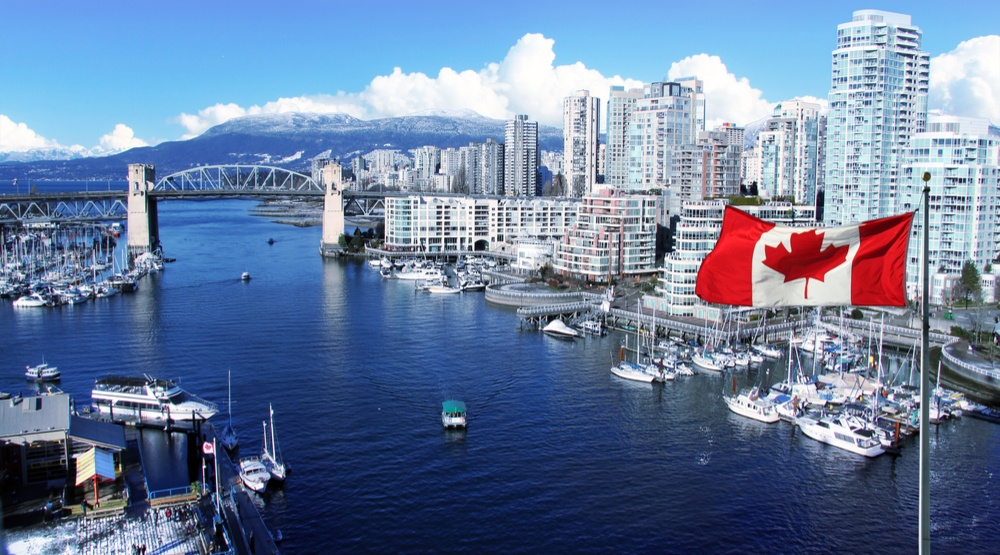 View-of-Vancouver-with-Canadian-flag-flying-HannamariahShutterstock